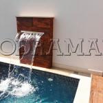 Como deixar sua  piscina mais elegante com uma cascata?